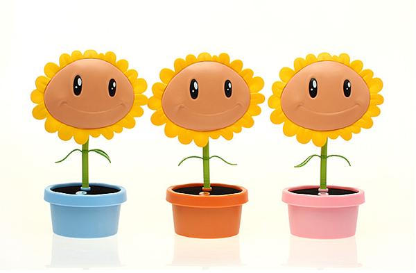 这是一个可爱的太阳花小台灯,可以进行usb充电,台灯上边的太阳花